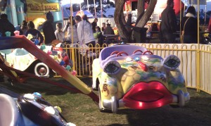personified car with a face on a sideshow ride