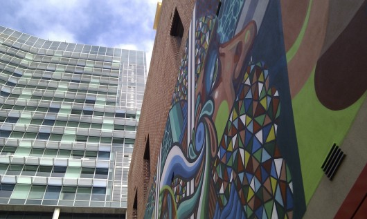 mural by Beastman and Vans the Omega and skyscraper at 140 in Perth